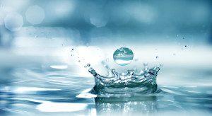 Splash water. Bright blue background