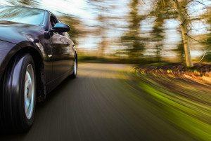 Luxury sedan driving fast.